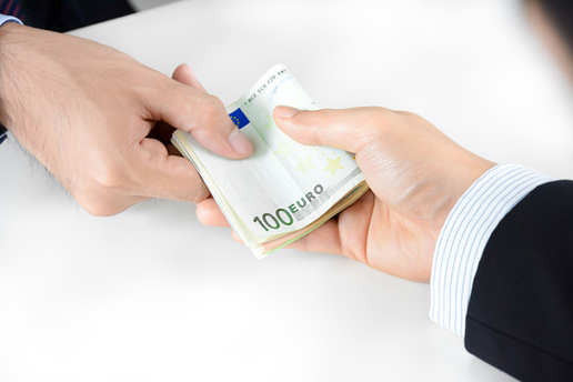 Businessman hands passing money, Euro currency (EUR) - bribery concept